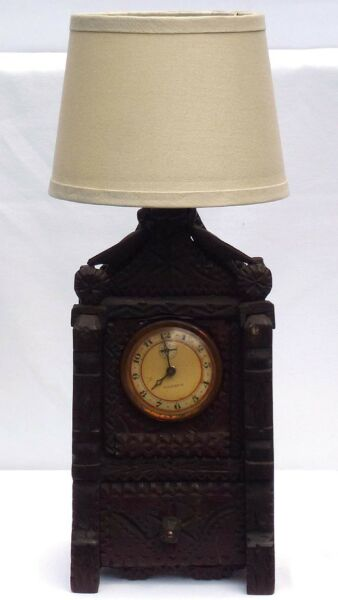 A tramp art lamp with a clock and drawer. A Wonderful unusual piece.