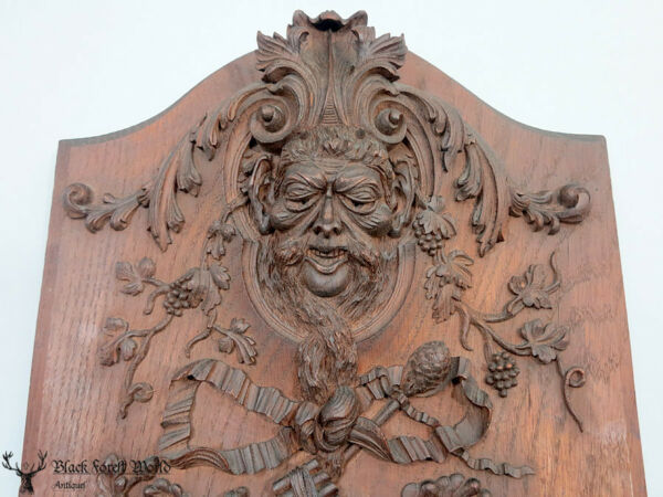 awesome wood carved black forest grotesque faun plaque signed