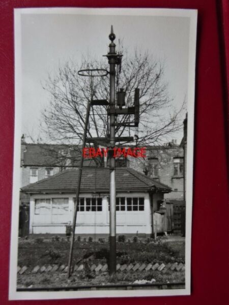 PHOTO WEST EALING SIGNAL IN FRON OF OLD SIGNAL BOX