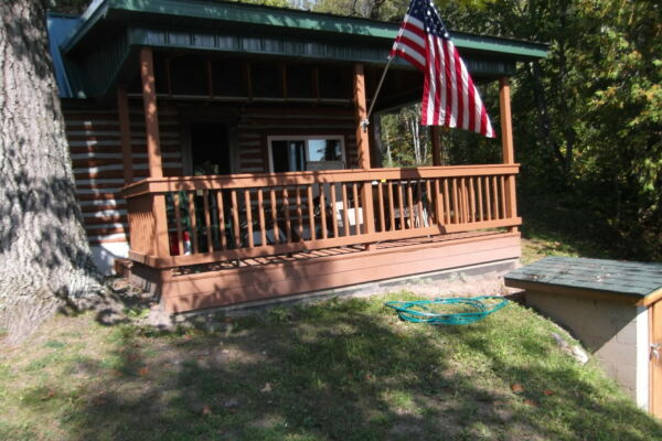 Rustic Log Cabin Home located on Beautiful Thunder Bay River w View