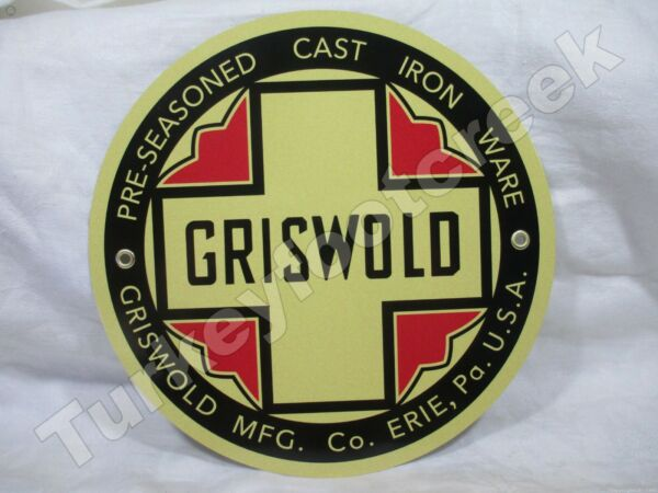 11.75in ROUND GRISWOLD CAST IRON WARE METAL SIGN