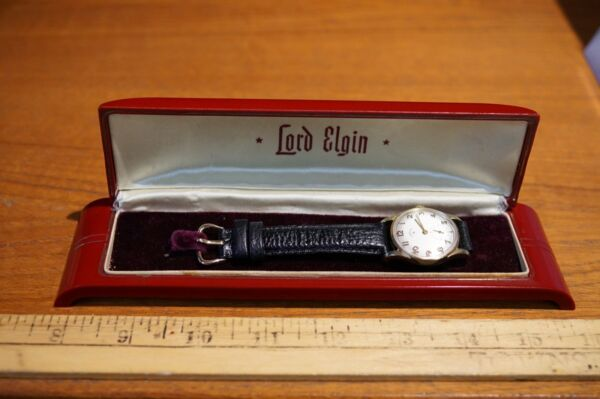 Vintage (early 50s) SOLID 14K LORD ELGIN 14K Buckle Bakelite case. RESTORED