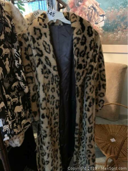 Gorgeous faux African Leopard full floor length coat that originally cost $1200 $600.00