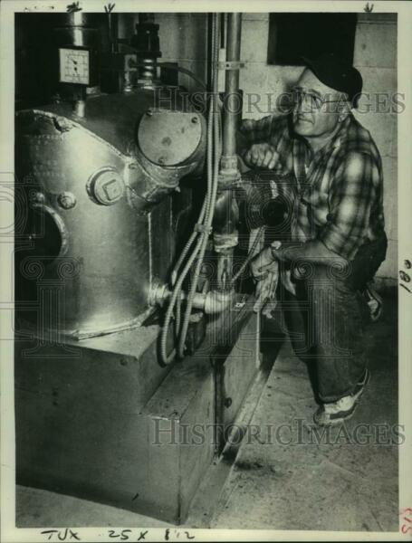 1977 Press Photo Michael Mudar checks on a boiler in Albany New York $19.99