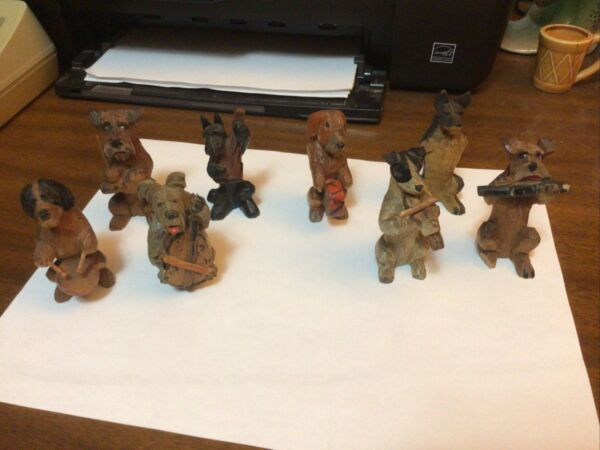 Hand Carved Wooden Dog Band8 pcs.used condition $89.99