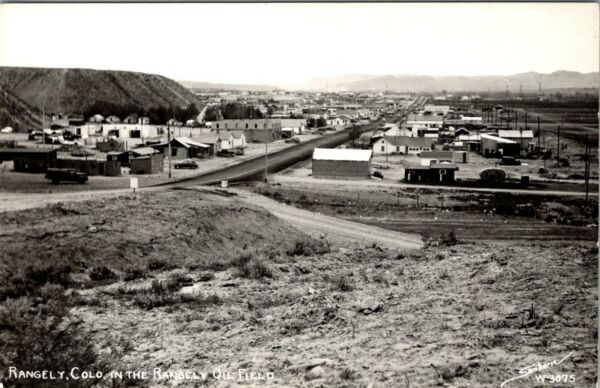 RANGELY COLORADO TOWN VIEW IN THE OIL FIELD VINTAGE SANBORN PHOTO POSTCARD