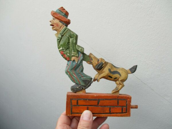 An Antique Vintage Black Forest Wooden Articulated ANRI Dog Chasing Man RARE