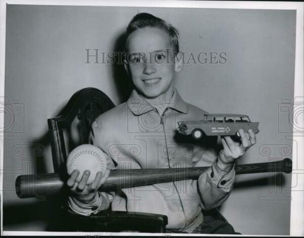 1957 Press Photo 12 Year Old Jimmy Thoma Saves Baby from Fall Shows Reward Toys $13.88