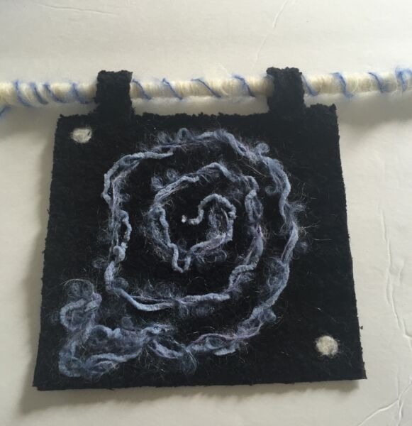 Black Fabric fiber art wall hanging Square With Felted Blue Yarn Flower