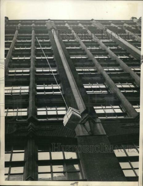 1936 Press Photo New York Package coming down from ninth floor of building NYC $19.99