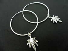 "A PAIR OF SILVER PLATED 37MM 1.5"" HOOP & CANNABIS WEED LEAF EARRINGS. NEW."