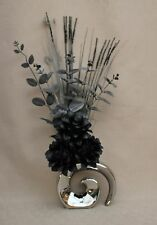 ARTIFICIAL SILK BLACK DRAGON FLOWERS WITH FOLIAGE IN SILVER METALLIC FOSSIL VASE