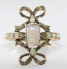 "UNUSUAL 9K GOLD VINTAGE INS AUS OPAL""TIE THE KNOT"" RING"