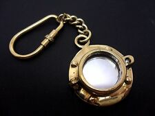 A LOVELY BRASS SHIPS PORTHOLE/MIRROR NAUTICAL KEY RING. NEW.