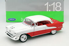 Oldsmobile Super 88 Convertible Baujahr 1955 rot / weiß 1:18 Welly