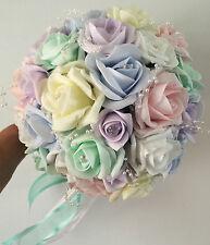 Wedding flowers light Pastel colours Brides. Bridesmaid bouquet