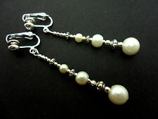A PAIR TIBETAN SILVER IVORY GLASS BEAD  EXTRA LONG DANGLY CLIP ON EARRINGS. NEW.