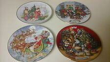 AVON CHRISTMAS COLLECTIBLE  PLATES  SET OF 4 1990,91,92,93 TRIM IS 22 GOLD