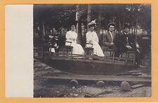 Real Photo Postcard RPPC - Two Men Two Women on Dismounted Carnival Ride