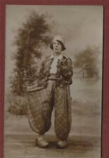 Young lady, clogs Dutch costume pipe jacket pantaloons  vintage  postcard ga.46