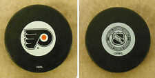 LOT OF 2 HOCKEY PUCKS -NHL OFFICIAL IN GLAS CO - PHILADELPHIA FLYERS - FREE SHIP