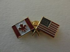 VINTAGE US AND CANADA FLAG PIN BACK