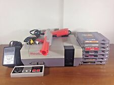 Bundled Nintendo Entertainment System (NES) + 8 Games + 1 Gun + 1 Controller