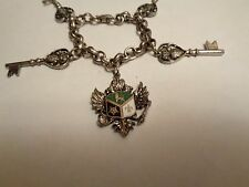 Vintage Signed  CORO Silver Tone Key & Enamel Coat of Arms Shield Charm Bracelet