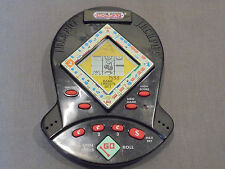 1999 MONOPOLY JACKPOT HANDHELD ELECTRONIC SLOT MACHINE GAME BY HASBRO