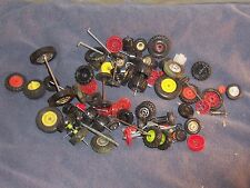 LOT Of TOY FRONT AND REAR TIRES, AXLES AND RED RIMS