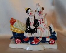 VINTAGE CWI PORCELAIN FIGURINE OF TWO CLOWNS SITTING IN A CAR G3