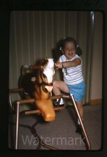 1967 Kodachrome photo slide young girl with toy rocking horse