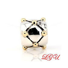 AUTHENTIC CHAMILIA SILVER WITH 14KT YELLOW GOLD GOLD DOT X EUROPEAN BEAD