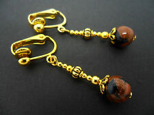A PAIR GOLD PLATED DANGLY BLACK/BROWN GOLDSTONE CLIP ON EARRINGS. NEW.