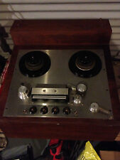 Vintage Ampex real to real tape recorder in unit.