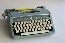 Vintage Brother De Luxe powder blue portable typewriter with original case