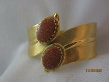 VINTAGE GOLD TONE HINGED CLAMPER BRACELET W/ GOLDSTONE GLASS CABOCHON ACCENTS