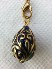 Dark blue enamel Easter egg pendant with goldtone overlay design