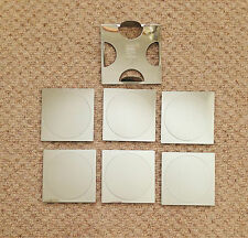 "A SET OF SIX  3.375"" WIDE STAINLESS STEEL SQUARE-SHAPED COASTERS c/w STAND"
