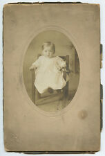 BABY IN CHAIR HOLDING RATTLE/BELLS FROM DUQUESNE, PA, ANTIQUE STUDIO PHOTO