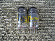x2 yellow printed u.s.a glass tube 12ax7 with tested good.