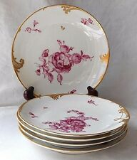 FIVE C20TH HAND PAINTED CONTINENTAL PORCELAIN PLATES DECORATED WITH FLOWERS
