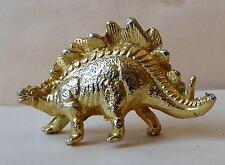 Fève en métal doré des années 90 - Les Dinosaures - Un Dino