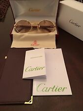 Wood and Gold Cartier Glasses.