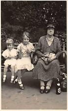 Old lady drinking bottle of beer on bench - 2 young girls glasses    qp1755