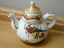 MINIATURE COFFEE POT WITH EXOTIC BIRD DESIGN