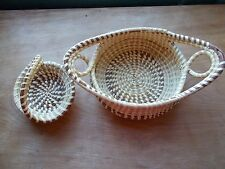 TWO SWEET GRASS BASKETS FROM  SOUTH CAROLINA  ONE LABEL AS HELEN BURNS
