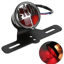 une moto rouge plaque mont conduit feu stop, frein conduit feu ST
