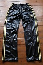 Adidas Chile 62 Tracksuit Pants. Shiny Black with Gold adidas stripes. size S