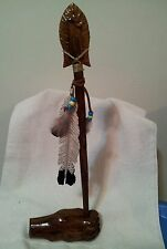 Hand carved cottonwood bark Hand, spear and feather sculpture